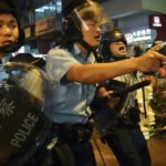 Hong Kong protest escalation: Tear gas, water cannons and a police officer firing a warning shot