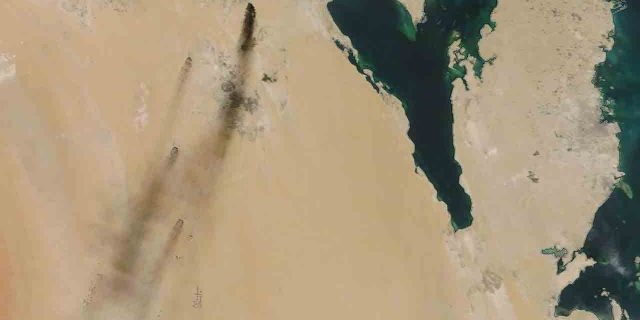 This Saturday, Sept. 14, 2019, satellite image provided by NASA Worldview shows fires following Yemen's Houthi rebels claiming a drone attack on two major oil installations in eastern Saudi Arabia.
