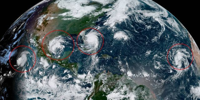 This image, taken on Tuesday, Sept. 3, 2019, shows tropical activity in the Pacific and Atlantic Oceans. Hurricane Juliette can be seen to the left far southwest off Mexico. A new system can be seen in between Juliette and Hurricane Dorian, currently swirling off Florida.