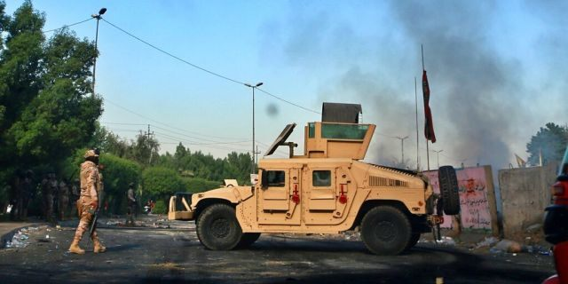 Iraqi Army troops deployed at a site of protests in Baghdad on Sunday. (AP Photo/Khalid Mohammed)