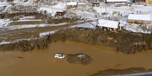 In this image made from video provided by Russian Emergency Situations Ministry press service, a view after the dam collapse during heavy rain on Saturday.