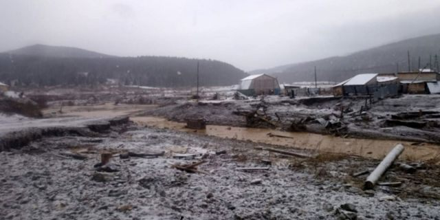 In this image made from video provided by Russian Emergency Situations Ministry press service, a view after the collapse of dam during heavy rain occurred near the village of Shchetinkino, on Saturday.