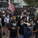Hong Kong teen shot by police during pro-democracy protests now risks 10-year jail sentence