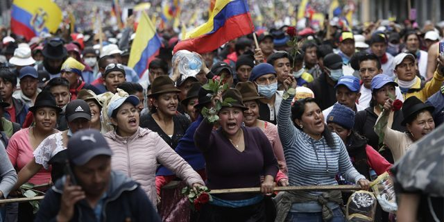 Indigenous antigovernment demonstrators chant slogans against President Lenin Moreno and his economic policies during a nationwide strike in Quito on Wednesday. (AP)