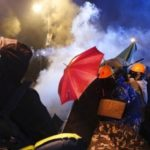 Hong Kong police storm Polytechnic University as protesters set fires to entrance