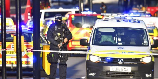 Armed police guard the scene of an incident on London Bridge. (Dominic Lipinski/PA via AP)