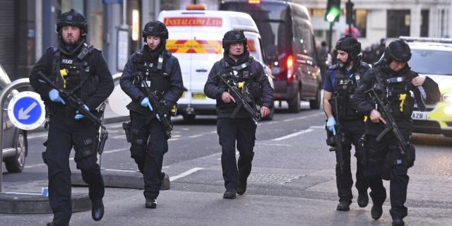 Police on Cannon Street in London near the scene of an incident on London Bridge on Friday. (Kirsty O'Connor/PA via AP)