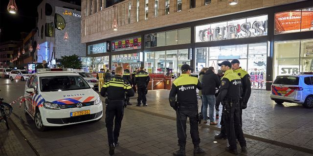 Dutch police blocked a shopping street after a stabbing incident in the center of The Hague, Netherlands, on Friday. (AP Photo/Phil Nijhuis)