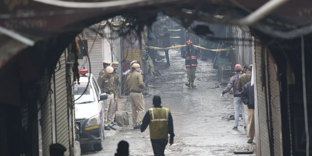 Police officers cordon off the site of a fire in a narrow lane in New Delhi, India, Sunday, Dec. 8, 2019. A doctor at a government-run hospital says dozens have died in a major fire in central New Delhi. (Associated Press)