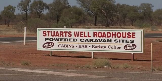 In this image made from video, an advertisement for the campsite line the roadside where a woman was found after being stranded in the Alice Springs area in the central Australian Outback.