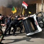 US Embassy compound in Baghdad under siege as crowds protesting airstrikes break through gate