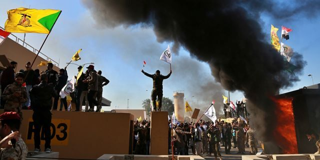 Protesters burn property in front of the U.S. embassy compound. (AP)