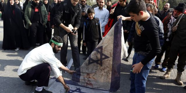 Protesters in Tehran burn representations of Israeli flag during a demonstration over the U.S. airstrike in Iraq that killed Iranian Revolutionary Guard Gen. Qassem Soleimani.