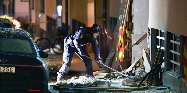 Police work at the scene of an explosion that caused damage to a residential building in central Stockholm, early Monday, Jan. 13, 2020. There were no reported injuries. (Anders Wiklund/TT News Agency via AP)