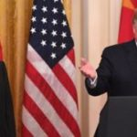 US and China sign deal to ease trade war
