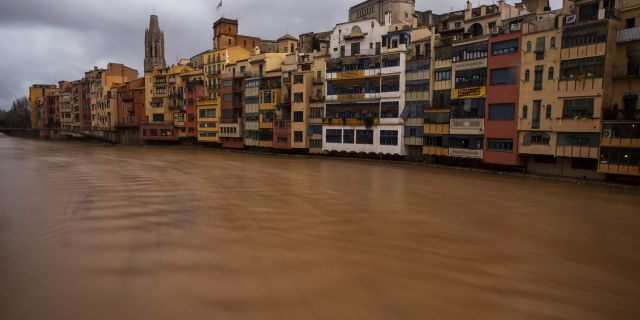 The river Onyar is seen swollen during a storm in Girona, Spain, on Thursday, Jan. 23, 2020.