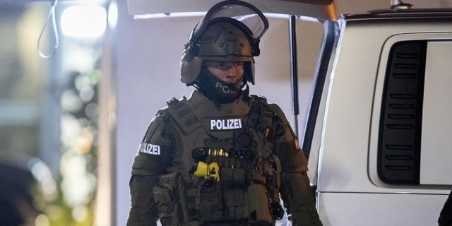 A special forces officer guards the road in front of a house that is searched through by police in Hanau, Germany, Thursday, Feb. 20, 2020. (Associated Press)