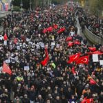 Thousands mourn victims of Germany shooting massacre with massive march