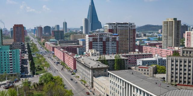 Tallest building and skyline of Pyongyang in North Korea, capital of DPRK (Democratic people republic of Korea), road, cars and skyscrapers