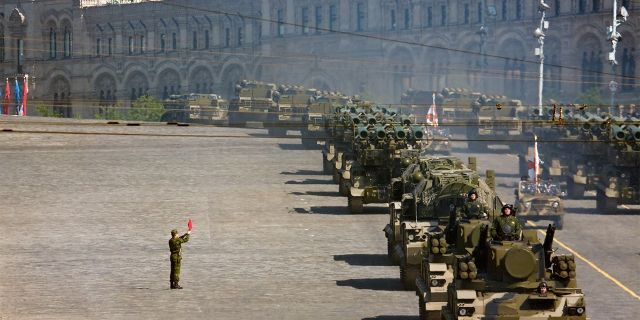 Russian soldiers stand near a convoy of rocket launchers in military parade rehearsal on Red Square, Moscow, in 2008.