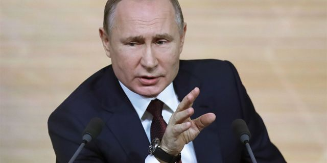 Russian President Vladimir Putin gestures during his annual news conference in Moscow, Russia, in December.