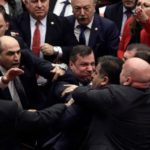 Brawl breaks out in Turkey's parliament over Syria involvement, Erdogan meets with Putin