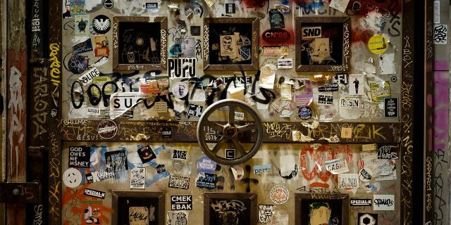 In this March 21, 2020, photo, stickers cover a door of the music clubs Sage and KitKatClub in Berlin, Germany. Berlin's nightclubs were closed March 13 to help slow the spread of the virus. (AP Photo/Markus Schreiber)