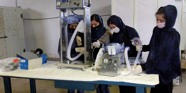 Girls developing two types of cheap ventilator devices using car spare parts to help the fight against the coronavirus pandemic in Herat, west of Kabul, Afghanistan. (AP Photo/Hamed Safarazi)