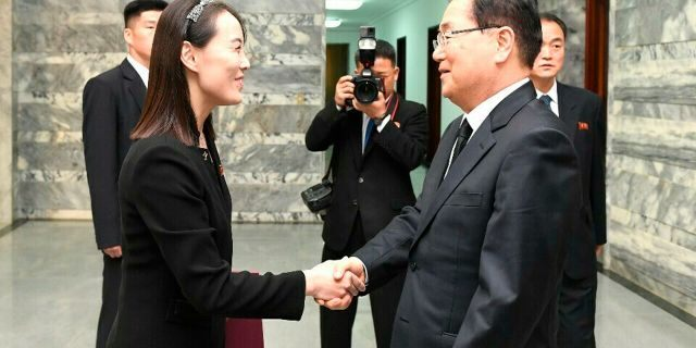 In this photo provided by South Korea Unification Ministry, North Korean leader Kim Jong Un's sister, Kim Yo Jong, a senior official of North Korea's ruling party, left, shakes hands with South Korean presidential national security director Chung Eui-yong, right, at the northern side of the border village of Panmunjom in the Demilitarized Zone, South Korea, Wednesday, June 12, 2019. North Korean leader Kim Jong Un sent flowers and a message of condolence on Wednesday for the funeral of former South Korean first lady Lee Hee-ho, whose late husband held a historic summit with Kim's father in 2000. (South Korea Unification Ministry via AP)