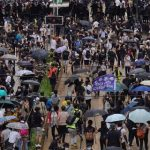 Hong Kong police fire tear gas, water canon as pro-democracy supporters protest new China law