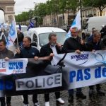 French police throw down handcuffs, 'insulted' after being accused of brutality, racism