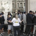 Shoppers pack stores in England as coronavirus restrictions ease