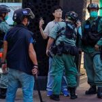Hong Kong police arrest dozens of protesters amid China's review of national security bill