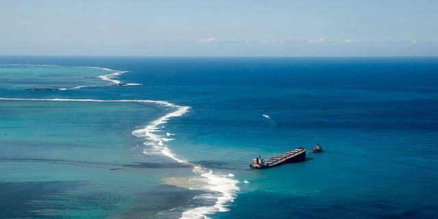 This photo provided by the French Army shows oil leaking from the MV Wakashio, a bulk carrier ship that ran aground off the southeast coast of Mauritius, Tuesday Aug.11, 2020.