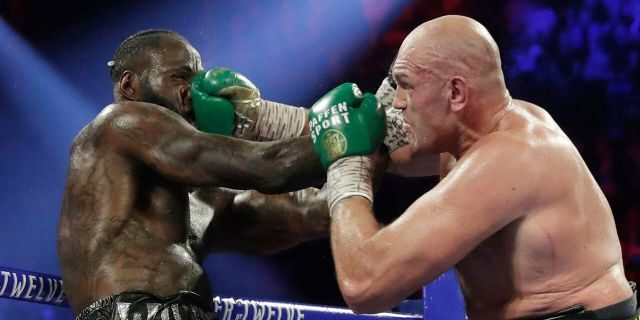 Tyson Fury, of England, lands a right to Deontay Wilder during a WBC heavyweight championship boxing match Feb. 22, in Las Vegas. (AP Photo/Isaac Brekken)
