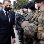 Macron declares France 'under attack' after church beheading, bolsters security at schools, religious sites