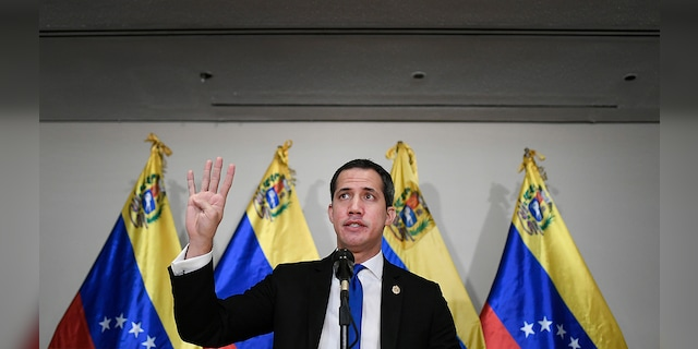 Venezuelan opposition leader Juan Guaido speaks at a press conference in Caracas, Venezuela, Saturday, Dec. 5, 2020, a day before parliamentary elections. (AP Photo/Matias Delacroix)