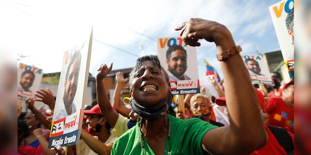 "Supporters of Nicolas Maduro Guerra, the only son of Venezuela's President Nicolas Maduro, cheer at a rally for the 30-year-old politico — commonly called ""Nicolasito,"" or ""Little Nicolás"", in Maiquetía, Venezuela, Sunday, Nov. 29, 2020. (AP Photo/Ariana Cubillos)"