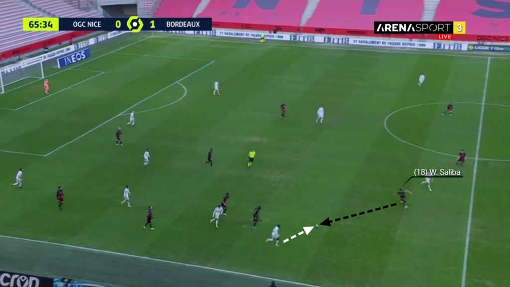 Spotting the loose ball, Saliba accelerates to win the challenge.