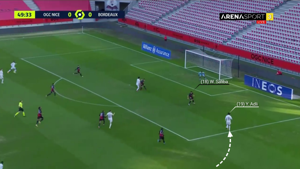 Adli runs towards goal and Saliba stands his ground, not diving in.