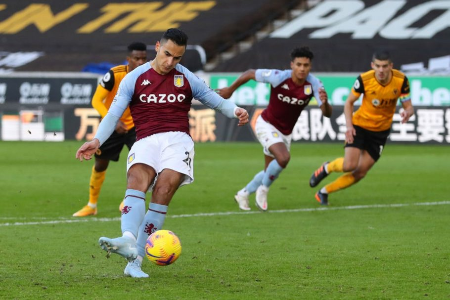 WOLVERHAMPTON, ENGLAND - DECEMBER 12: Anwar El Ghazi of Aston Villa scores a penalty for his team's first goal during the Premier League match between Wolverhampton Wanderers and Aston Villa at Molineux on December 12, 2020 in Wolverhampton, England. The match will be played without fans, behind closed doors as a Covid-19 precaution. (Photo by Catherine Ivill/Getty Images)