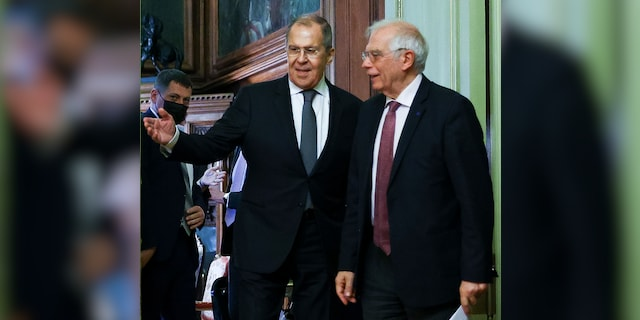 In this photo released by the Russian Foreign Ministry Press Service, Russian Foreign Minister Sergey Lavrov, left, welcomes High Representative of the EU for Foreign Affairs and Security Policy, Josep Borrell to attend a joint news conference following their talks in Moscow, Russia, Friday, Feb. 5, 2021. (Russian Foreign Ministry Press Service via AP)