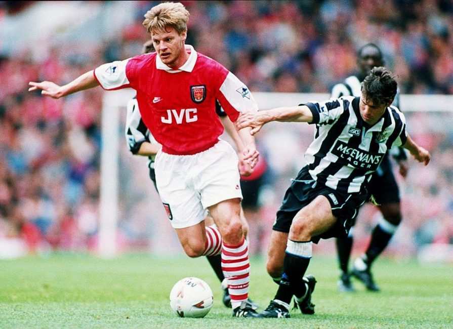 18 SEP 1994: STEFAN SCHWARZ OF ARSENAL SOCCER CLUB IS CHASED BY ROBERT LEE OF NEWCASTLE SOCCER CLUB DURING THEIR MATCH AT ARSENAL. Mandatory Credit: Ben Radford/ALLSPORT