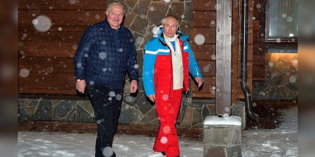 Russian President Vladimir Putin, right, and Belarusian President Alexander Lukashenko walk during their meeting at the Black Sea resort of Sochi, Russia, Monday, Feb. 22, 2021. Putin hosted his Belarusian counterpart Alexander Lukashenko for talks on Monday, amid media reports suggesting that the leader of Belarus was coming to Russia to secure one more loan. (Alexei Druzhinin, Sputnik, Kremlin Pool Photo via AP)