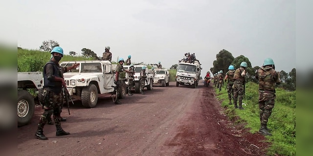 In this image from video, United Nations peacekeepers guard the area where a U.N. convoy was attacked. (AP Photo/Justin Kabumba)