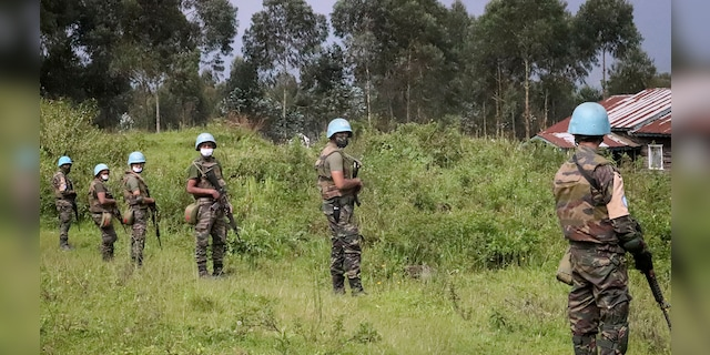 United Nations peacekeepers guard the area where a U.N. convoy was attacked and the Italian ambassador to Congo killed, in Nyiragongo, North Kivu province, Congo Monday, Feb. 22, 2021. (AP Photo/Justin Kabumba)