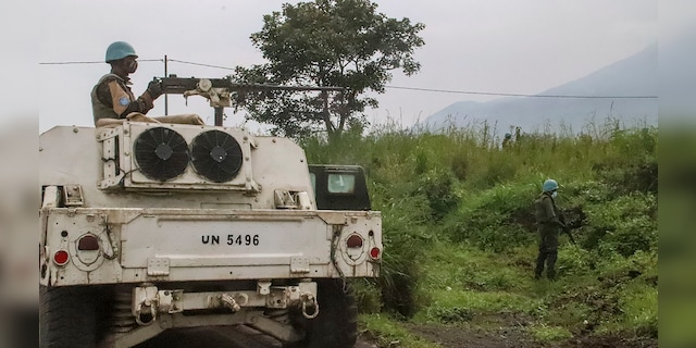 United Nations peacekeepers guard the area where a U.N. convoy was attacked and the Italian ambassador to Congo killed. (AP Photo/Justin Kabumba)