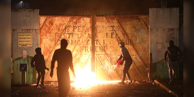 Nationalists and Loyalists clash with one another at the peace wall on Lanark Way in West Belfast, Northern Ireland, Wednesday, April 7, 2021. The police had to close roads into the near by Protestant area as crowds from each divide attacked each other. (Associated Press)