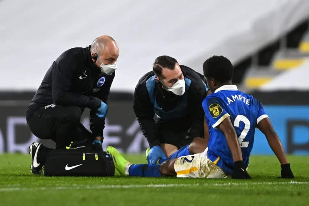 LONDON, ENGLAND - DECEMBER 16: Tariq Lamptey of Brighton and Hove Albion receives medical treatment during the Premier League match between Fulham and Brighton & Hove Albion at Craven Cottage on December 16, 2020 in London, England. The match will be played without fans, behind closed doors as a Covid-19 precaution. (Photo by Mike Hewitt/Getty Images)