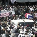 Taliban supporters hold mock funerals with coffins draped with American flags